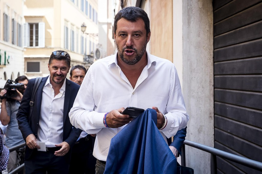 Italian Deputy-Premier and Interior Minister, Matteo Salvini, arrives for a meeting in Rome, Wednesday, Aug. 21, 2019. Italy could see elections as early as this fall after Italian Premier Giuseppe Conte resigned amid the collapse of the 14-month-old populist government. Matteo Salvini's right-wing League party sought a no-confidence vote against Conte earlier this month, a stunningly bold move for the government's junior coalition partner. (Angelo Carconi/ANSA via AP)
