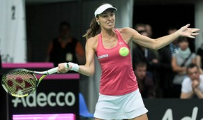 epa04711552 Switzerland's Martina Hingis in action against Urszula Radwanska of Poland during their singles match of the Tennis Fed Cup World Group playoff tie between Poland and Switzerland in Zielona Gora, Poland, 19 April 2015.  EPA/Lech Muszynski POLAND OUT
