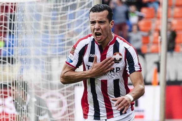 epa04365333 Ali Messaoud of Willem II Tilburg jubilates after his 2-1 goal during their Dutch league match against AZ Alkmaar in Tilburg, Netherlands, 23 August 2014.  EPA/TOIN DAMEN
