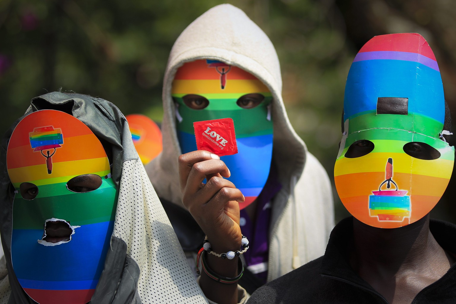 epa04098849 (FILE) A file picture dated 10 Februatry  2014 shows a masked Kenyan supporter of the LGBT community holds a condom as he joins others in protest against Uganda's anti-gay bill in front of the Ugandan High Commission in Nairobi, Kenya. Uganda's President Yoweri Museveni signed into law on 24 February 2014 anti-gay legislation that allows homosexuals to be punished with up to life in prison. The law has come under strong criticism abroad, with US President Barack Obama warning that it could 'complicate' Uganda's relations with one of its biggest aid donors.  EPA/DAI KUROKAWA *** Local Caption *** 51221749