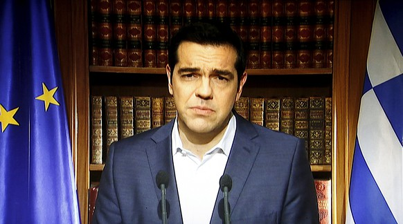 Greek Prime Minister Alexis Tsipras is seen on a television monitor while addressing the nation in Athens, Greece July 1, 2015. Tsipras called on Greeks to vote 'no' in Sunday's referendum on a bailout package offered by creditors, in a defiant address that dispelled speculation he was rowing back on the plan under mounting pressure.  REUTERS/ERT/Pool      TPX IMAGES OF THE DAY