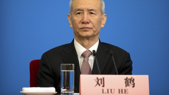 Vice Premier Liu He attends a press conference after the closing session of China's National People's Congress (NPC) at the Great Hall of the People in Beijing, Tuesday, March 20, 2018. Chinese Premier Li Keqiang appealed to Washington on Tuesday to