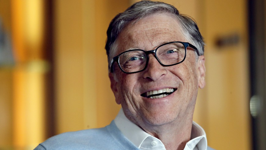 In this Feb. 1, 2019, Bill Gates smiles while being interviewed in Kirkland, Wash. Bill and Melinda Gates are pushing back against a new wave of criticism about whether billionaire philanthropy is a force for good. The couple, whose foundation has the largest endowment in the world, said they're not fazed by recent blowback against wealthy giving, including viral moments at the World Economic Forum and the shifting political conversation about taxes and socialism. (AP Photo/Elaine Thompson)