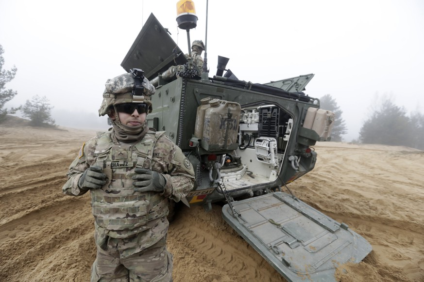 Soldiers of the U.S. Army's 2nd Cavalry Regiment, deployed in Latvia as part of NATO's Operation Atlantic Resolve, are pictured near their armored vehicle named