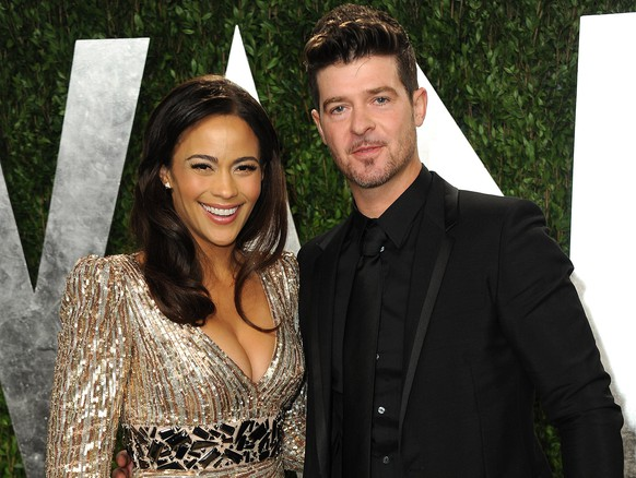 FILE - In this Feb. 24, 2013 file photo, Paula Patton and Robin Thicke arrive at the 2013 Vanity Fair Oscars Viewing and After Party at the Sunset Plaza Hotel in West Hollywood, Calif. Patton, the