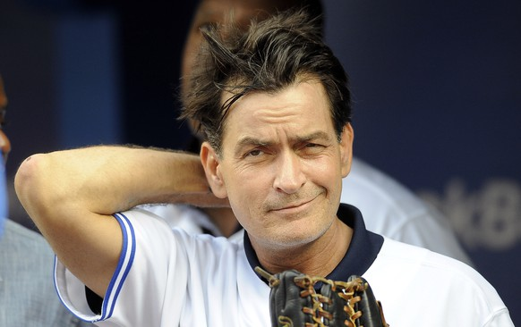 FILE - FEBRUARY 15:  Actor Charlie Sheen is engaged to former adult film star Brett Rossi. TORONTO, CANADA - AUGUST 14:  Actor Charlie Sheen throws out the ceremonial first pitch prior to MLB game action between the Toronto Blue Jays and Chicago White Sox August 14, 2012 at Rogers Centre in Toronto, Ontario, Canada. (Photo by Brad White/Getty Images)