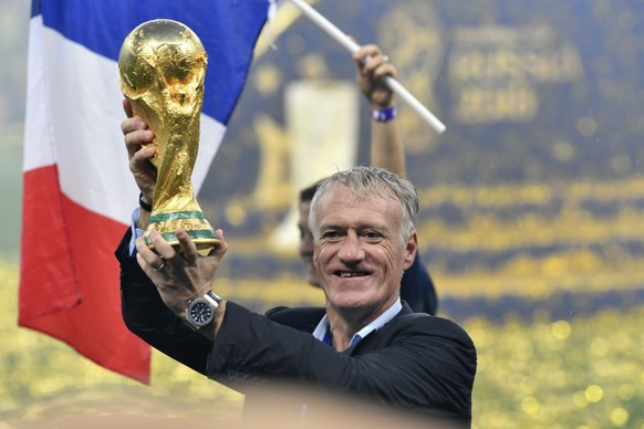 France head coach Didier Deschamps lifts the trophy after France beat Croatia by 4-2 during the final match between France and Croatia at the 2018 soccer World Cup in the Luzhniki Stadium in Moscow, Russia, Sunday, July 15, 2018. (AP Photo/Martin Meissner)