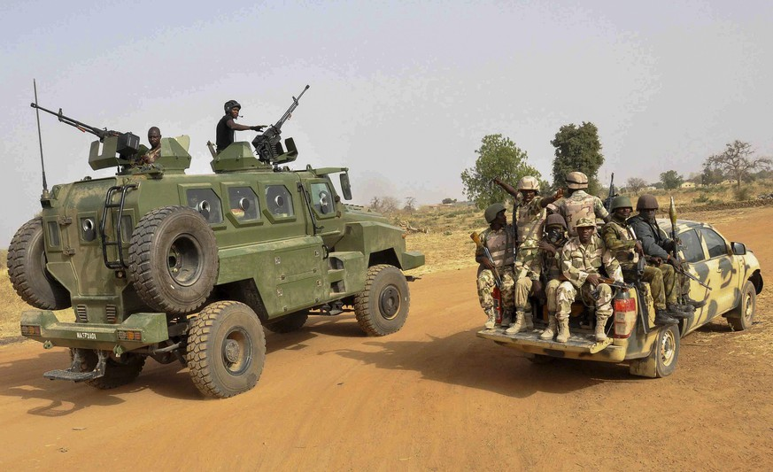 epa04653431 A photograph made available 08 March 2015 shows the Nigerian army patroling in Chibok, Borno State, North Eastern Nigeria 05 March 2015.  According to reports two busy markets and a bus station wre the targets of an alleged Boko Haram suicide attack which killed 54 people and injured 143 in the city of Maiduguri in north-eastern Nigeria 07 March 2015.  EPA/Henry Ikechukwu