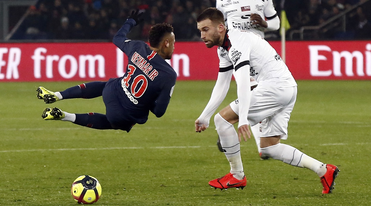 PSG's Neymar, left, is fouled by Guingamp's Lucas Deaux during the League One soccer match between Paris Saint Germain and Guingamp at the Parc des Princes stadium in Paris, Saturday, Jan. 19, 2019. (AP Photo/Michel Euler)