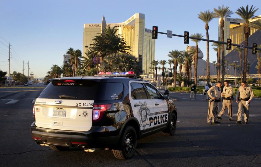 epa06242252 Police officers block Las Vegas Boulevard in front of the Mandalay Bay Hotel and Casino where a gunman fired from during the Route 91 Harvest festival on Las Vegas Boulevard in Las Vegas, Nevada, USA, 03 October 2017. Police reports indicate that a gunman, identified as Stephen Paddock, 64, firing from an upper floor in the Mandalay Bay hotel killed more than 50 people and injured more than 500 before he reportedly killed himself as police made their way to his hotel room.  EPA/PAUL BUCK
