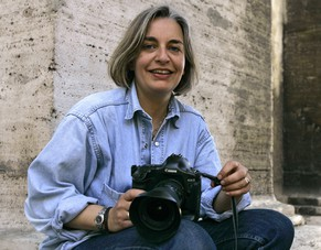 FILE - In this April 7, 2005 file photo, Associated Press photographer Anja Niedringhaus poses in Rome. Niedringhaus, 48, was killed and an AP reporter was wounded on April 4, 2014, when an Afghan policeman opened fire while they were sitting in their car in eastern Afghanistan. The International Women's Media Foundation announced Tuesday, April 15, 2014, that it has created a new award for courage honoring Niedringhaus. The award is funded with a $1 million gift from the Howard G. Buffett Foundation, a private family foundation that seeks to improve the lives of the world's poor and marginalized _ often the subjects of Niedringhaus' photographs. (AP Photo/Peter Dejong, File)