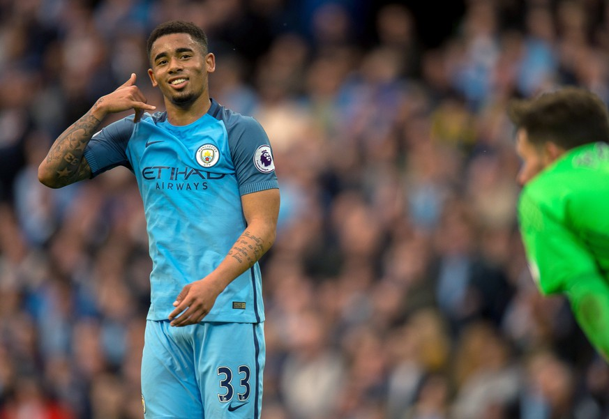 epa05968403 Manchester City's Gabriel Jesus celebrates scoring the opening goal during the English Premier League soccer match between Manchester City and West Bromwich Albion held at the Etihad Stadium, Manchester, Britain, 16 May 2017.  EPA/PETER POWELL EDITORIAL USE ONLY. No use with unauthorized audio, video, data, fixture lists, club/league logos or 'live' services. Online in-match use limited to 75 images, no video emulation. No use in betting, games or single club/league/player publications