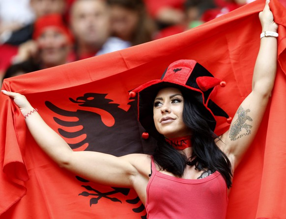 epa05367702 Supporter of Albania cheers prior to the UEFA EURO 2016 group A preliminary round match between France and Albania at Stade Velodrome in Marseille, France, 15 June 2016.  (RESTRICTIONS APPLY: For editorial news reporting purposes only. Not used for commercial or marketing purposes without prior written approval of UEFA. Images must appear as still images and must not emulate match action video footage. Photographs published in online publications (whether via the Internet or otherwise) shall have an interval of at least 20 seconds between the posting.)  EPA/GUILLAUME HORCAJUELO   EDITORIAL USE ONLY