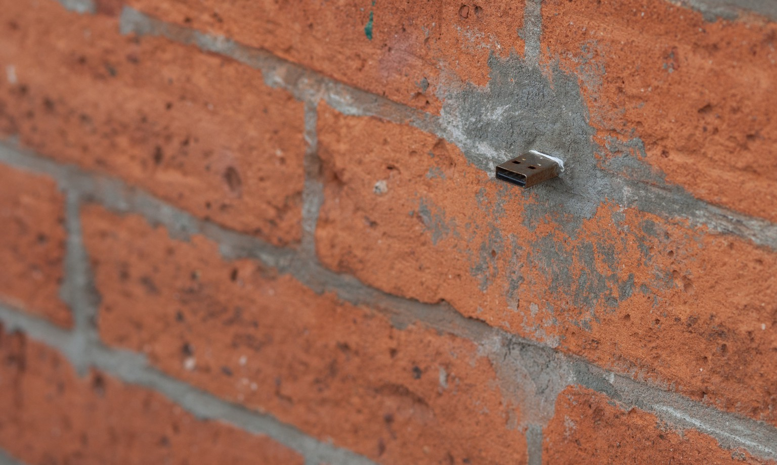 A USB drive is embedded in the brickwork on Third Avenue in Brooklyn.