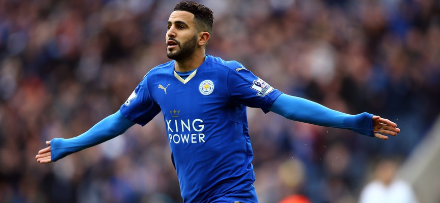 epa05275518 Leicester City's Riyad Mahrez celebrates his opening goal during the English Premier League soccer match between Leicester City and Swansea City at The King Power Stadium in Leicester, Britain, 24 April 2016.  EPA/TIM KEETON EDITORIAL USE ONLY. No use with unauthorized audio, video, data, fixture lists, club/league logos or 'live' services. Online in-match use limited to 75 images, no video emulation. No use in betting, games or single club/league/player publications.