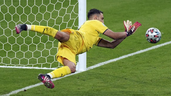 Italy goalkeeper Gianluigi Donnarumma makes a saves on a penalty shot from England's Bukayo Saka during the penalty shoot out during the Euro 2020 soccer championship final match between England and Italy at Wembley Stadium in London, Sunday, July 11, 2021. (Mike Egerton/PA via AP)