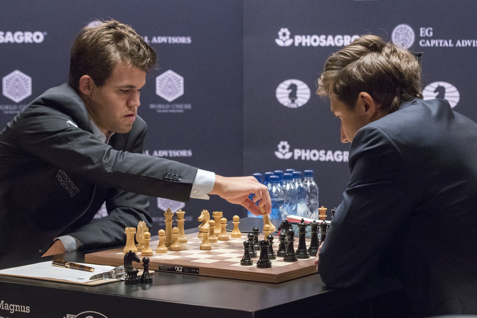 Chess world champion Magnus Carlsen, of Norway, left, makes a move against challenger Sergey Karjakin, of Russia, during the first round of the World Chess Championship, Friday, Nov. 11, 2016, in New York. (AP Photo/Mary Altaffer)