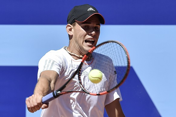 Dominic Thiem of Austria returns a ball to Pablo Carreno Busta of Spain during a quarter final game at the Suisse Open tennis tournament in Gstaad, Switzerland, Friday, July 31, 2015. (KEYSTONE/Peter Schneider)