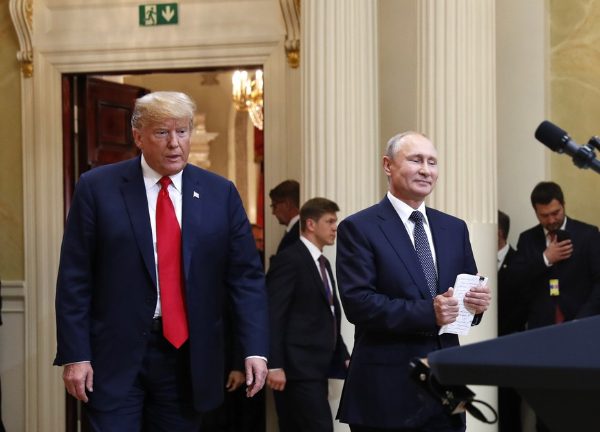 U.S. President Donald Trump, left, and Russian President Vladimir Putin arrive for a press conference after the meeting of U.S. President Donald Trump and Russian President Vladimir Putin at the Presidential Palace in Helsinki, Finland, Monday, July 16, 2018. (AP Photo/Pablo Martinez Monsivais)