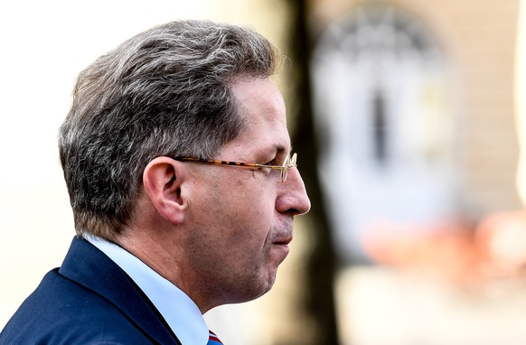 epa07012865 Hans-Georg Maassen, President of the German Federal Office for the Protection of the Constitution, arrives to the autumn reception of German federal security authorities in Berlin, Germany, 11 September 2018. The German domestic intelligence chief Maassen is under pressure by several politicians for denying far-right extremists had 'hounted' foreigners at Chemnitz protests. Maassen will be questioned on this issue by the Committee on Home Affairs of the Bundestag on 12 September 2018  EPA/FILIP SINGER