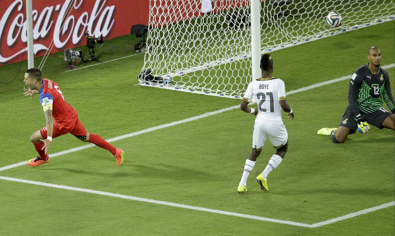 United States' Clint Dempsey, left, celebrates scoring the opening goal past Ghana's goalkeeper Adam Kwarasey, right, during the group G World Cup soccer match between Ghana and the United States at the Arena das Dunas in Natal, Brazil, Monday, June 16, 2014. (AP Photo/Hassan Ammar)