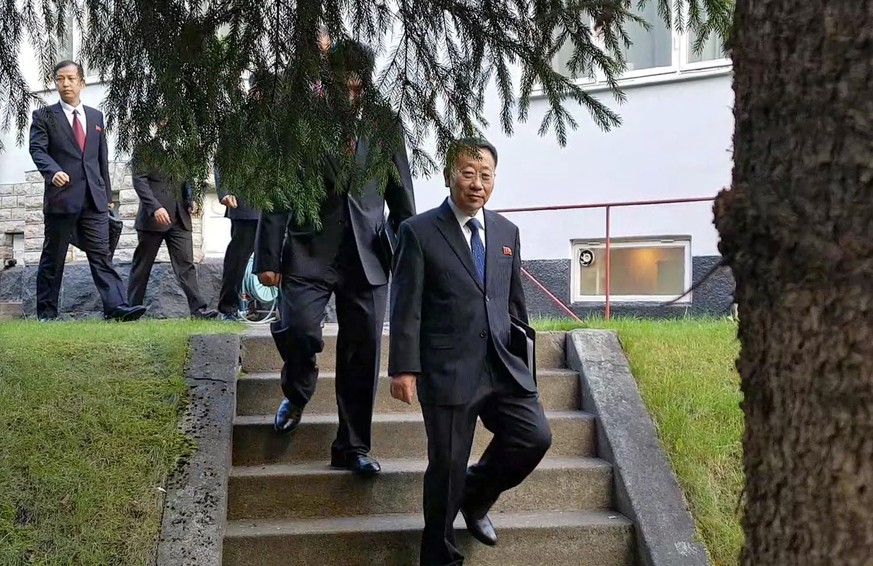 epa07897894 A handout photo made available by the Joint Press Corps shows North Korean delegates, including top negotiator Kim Myong-gil, leaving the North Korean embassy in Stockholm, Sweden, 05 October 2019, to attend a meeting with U.S. officials to prepare for formal working-level nuclear talks.  EPA/Joint Press Corps / HANDOUT SOUTH KOREA OUT HANDOUT EDITORIAL USE ONLY/NO SALES