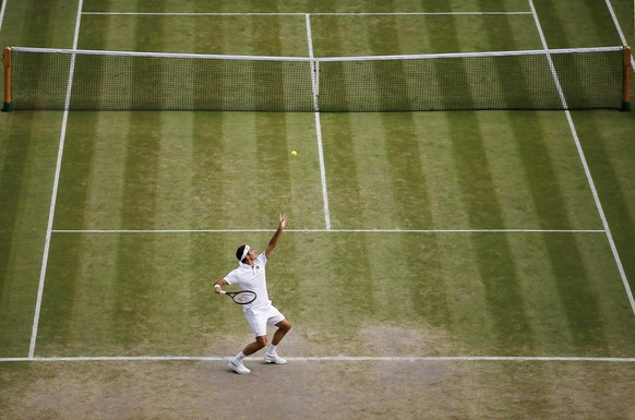 Switzerland's Roger Federer serves to Spain's Rafael Nadal during a men's singles semifinal match on day eleven of the Wimbledon Tennis Championships in London, Friday, July 12, 2019. (Andrew Couldridge /Pool Photo via AP)