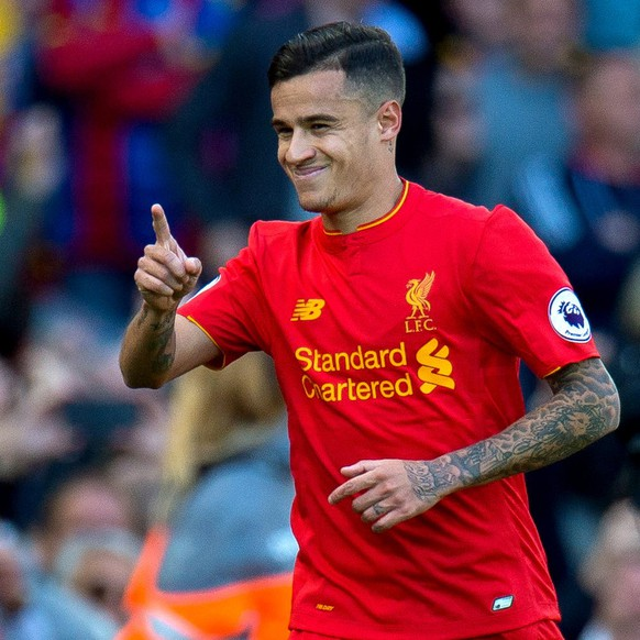 epa05923854 Liverpool's Philippe Coutinho celebrates scoring the opening goal during the English Premier League soccer match between Liverpool and Crystal Palace at Anfield, Liverpool, Britain, 23 April 2017.  EPA/PETER POWELL EDITORIAL USE ONLY. No use with unauthorized audio, video, data, fixture lists, club/league logos or 'live' services. Online in-match use limited to 75 images, no video emulation. No use in betting, games or single club/league/player publications EPA/PETER