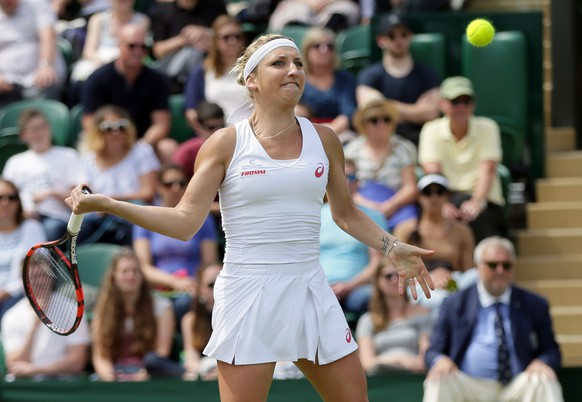 Timea Bacsinszky of Switzerland returns to Luksika Kumkhum of Thailand during their women's singles match on day four of the Wimbledon Tennis Championships in London, Thursday, June 30, 2016. (AP Photo/Tim Ireland)