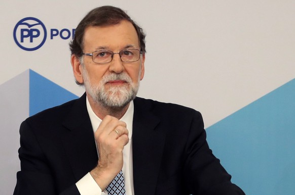 epa06786202 Former Spanish Prime Minister and leader of People's Party (PP), Mariano Rajoy, reacts as he attends a meeting of PP's national committee in Madrid, Spain, 05 June 2018. Rajoy has announced he is leaving the chairmanship of the party as he considers 'it's the best for PP, for me and for Spain'. Rajoy's resignation comes four days after he lost the no-confidence motion filed against him by the current Prime Minister, Pedro Sanchez. Rajoy has confirmed he will fullfill his mandate until the party choose his substitute.  EPA/BALLESTEROS