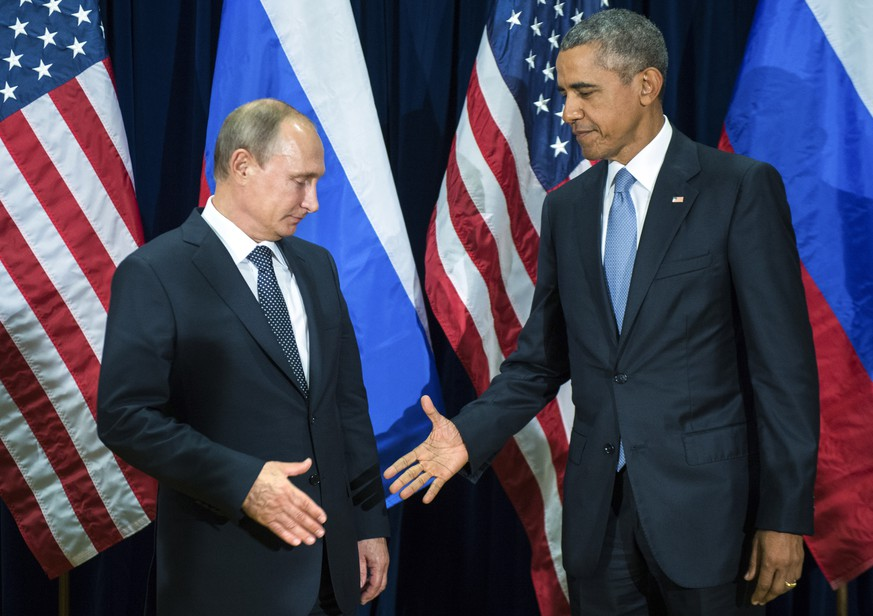 U.S. President Barack Obama, right, and Russia's President Vladimir Putin pose for members of the media before a bilateral meeting Monday, Sept. 28, 2015, at United Nations headquarters. (Mikhail Klimentyev/RIA-Novosti, Kremlin Pool Photo via AP)