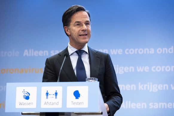 epa09147845 Resigning Prime Minister Mark Rutte explains the corona measures in The Hague, Netherlands, 20 April 2021. The cabinet has come up with a decision on the relaxation of the measures including lifting the night curfew on 28 April, allowing bars and restaurants to operate outdoor terraces and gradually opening universities.  EPA/SEM VAN DER WAL