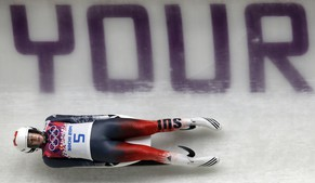 Martina Kocher of Switzerland speeds down the track in her first run during the women's singles luge competition at the 2014 Winter Olympics, Monday, Feb. 10, 2014, in Krasnaya Polyana, Russia. (AP Photo/Michael Sohn)