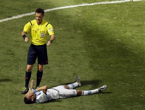 Referee Nicola Rizzoli from Italy request a stretcher as Argentina's Angel di Maria lies on the ground during the World Cup quarterfinal soccer match between Argentina and Belgium at the Estadio Nacional in Brasilia, Brazil, Saturday, July 5, 2014. (AP Photo/Thanassis Stavrakis)