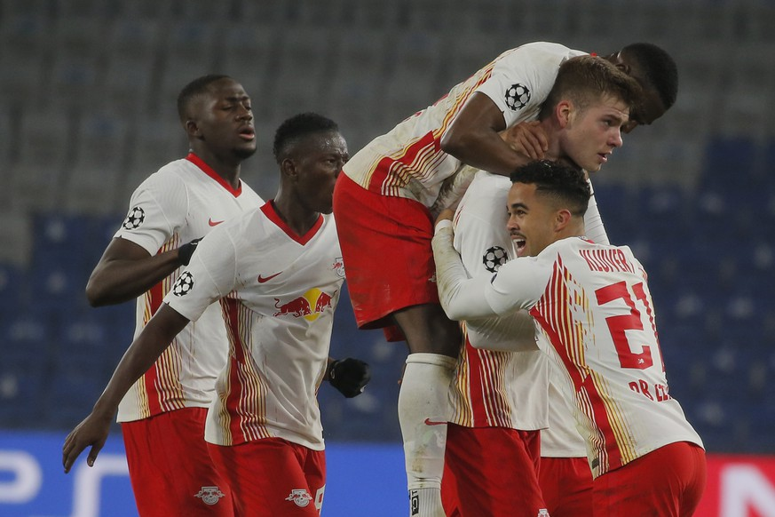 Leipzig's Alexander Sorloth, second right, celebrates with teammates his side's fourth goal during the Champions League group H soccer match between Istanbul Basaksehir and RB Leipzig at Fatih Terim Stadium in Istanbul, Wednesday, Dec. 2, 2020. Leipzig won 4-3. (AP Photo)