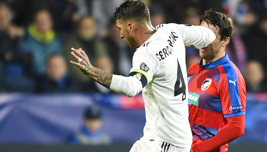 epa07149193 Real Madrid's Sergio Ramos (L) in action against Plzen's  Milan Havel (R) during the UEFA Champions League group G soccer match between Viktoria Plzen and Real Madrid in Plzen, Czech Republic, 07 November 2018.  EPA/FILIP SINGER