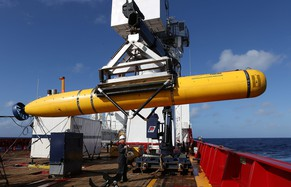 epa04173301 An undated handout picture made available by the Australian Department of Defense (DOD) on 20 April 2014 shows the Phoenix International Autonomous Underwater Vehicle (AUV) Artemis craned over the side of the Australian Defense Vessel (ADV) Ocean Shield in the search for missing Malaysia Airlines flight MH370, at sea in the Indian Ocean. Malaysia might widen the search area in the Indian Ocean and use more assets to try to find a passenger jet that went missing six weeks ago, a senior Malaysian official said on 19 April 2014. Transport Minister Hishammuddin Hussein said the plan to stop the use of a submersible drone next week in underwater search of Beijing-bound flight MH370, with 239 people on board, will not end the search operations. 'I have to stress that this is not to stop operations but to also consider other approaches which may include widening the scope of the search and utilising other assets that could be relevant in the search operation,' he said in a press briefing. 'The asset deployment committee has identified private companies that have the capabilities for deep-water salvage and recovery work, and other national assets that can be deployed to support this operation,' he added. Malaysia Airline flight MH370 went missing early 08 March 2014 while en route from Kuala Lumpur, Malaysia, to Beijing, China.  EPA/LSIS BRADLEY DARVILL/AUSTRALIAN DEFENCE DEPARTMENT AUSTRALIA AND NEW ZEALAND OUT HANDOUT EDITORIAL USE ONLY
