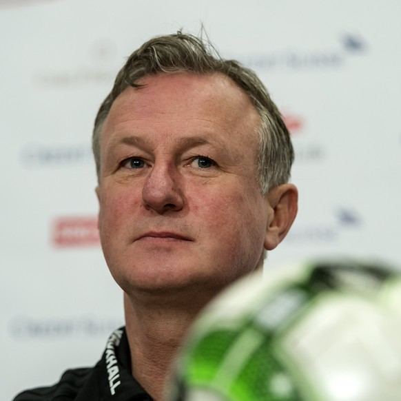epa06323125 Northern Ireland's head coach Michael O'Neill speaks during a press conference of Northern Irelands national soccer team, the day before the 2018 FIFA World Cup play-off second leg soccer match between Switzerland and Northern Ireland, in the St. Jakob-Park stadium in Basel, Switzerland, 11 November 2017.  EPA/GEORGIOS KEFALAS