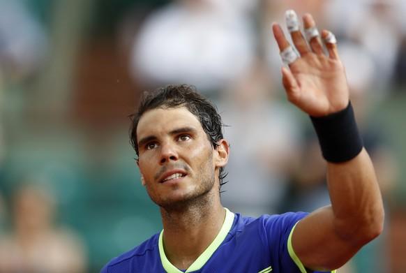 Spain's Rafael Nadal waves after defeating Georgia's Nikoloz Basilashvili during their third round match of the French Open tennis tournament at the Roland Garros stadium, Friday, June 2, 2017 in Paris. Nadal won 6-0, 6-1, 6-0. (AP Photo/Petr David Josek)
