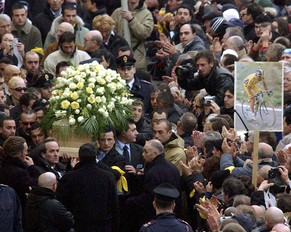 The coffin of Italian cycling legend and former Tour de France and Giro d'Italia race winner Marco Pantani is carried outside the San Giacomo church in Cesenatico, northern Italy, Wednesday, Feb. 18, 2004. Pantani, 34, was found dead in a residence in Rimini, northern Italy, Saturday Feb.14, 2004.  (AP Photo/Luca Bruno)