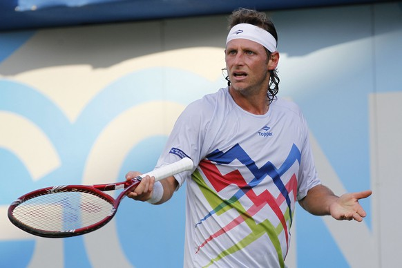 Argentina's David Nalbandian reacts to an umpire decision as he plays against Belgium's Ruben Bemelmans during their Queen's Club grass court championships second round tennis match in London, Wednesday, June 13, 2012. (AP Photo/Sang Tan)