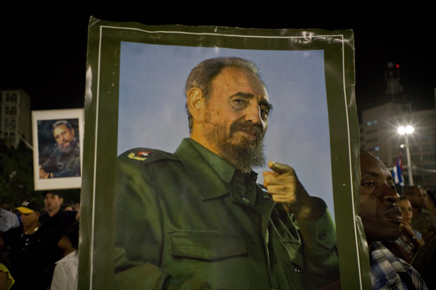A picture of Fidel Castro is held during a rally honoring the late Cuban leader at the Revolution Plaza in Havana, Cuba, Tuesday, Nov. 29, 2016. Schools and government offices were closed Tuesday for a second day of homage to Fidel Castro, with the day ending in a rally on the wide plaza where the Cuban leader delivered fiery speeches to mammoth crowds in the years after he seized power.Fidel Castro passed away Friday Nov. 25. He was 90.(AP Photo/Ramon Espinosa)