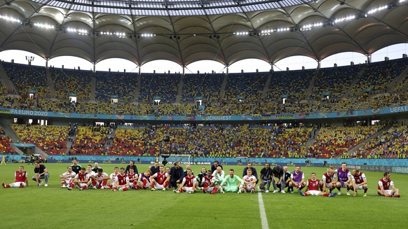 Team Austria celebrate after the Euro 2020 soccer championship group C match between Ukraine and Austria at the National Arena stadium in Bucharest, Monday, June 21, 2021. (Marko Djurica/Pool via AP)