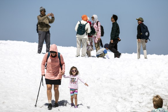 epa07674787 Tourists enjoy the summer temperatures on the Titlis mountain, near Engelberg, Switzerland, 26 June 2019. Europe is bracing itself for a heatwave, as forcasters predict temperatures are expected to climb above 40 degrees Celsius in some areas due to The exceptionally hot air that has arrived from the Sahara.  EPA/ALEXANDRA WEY