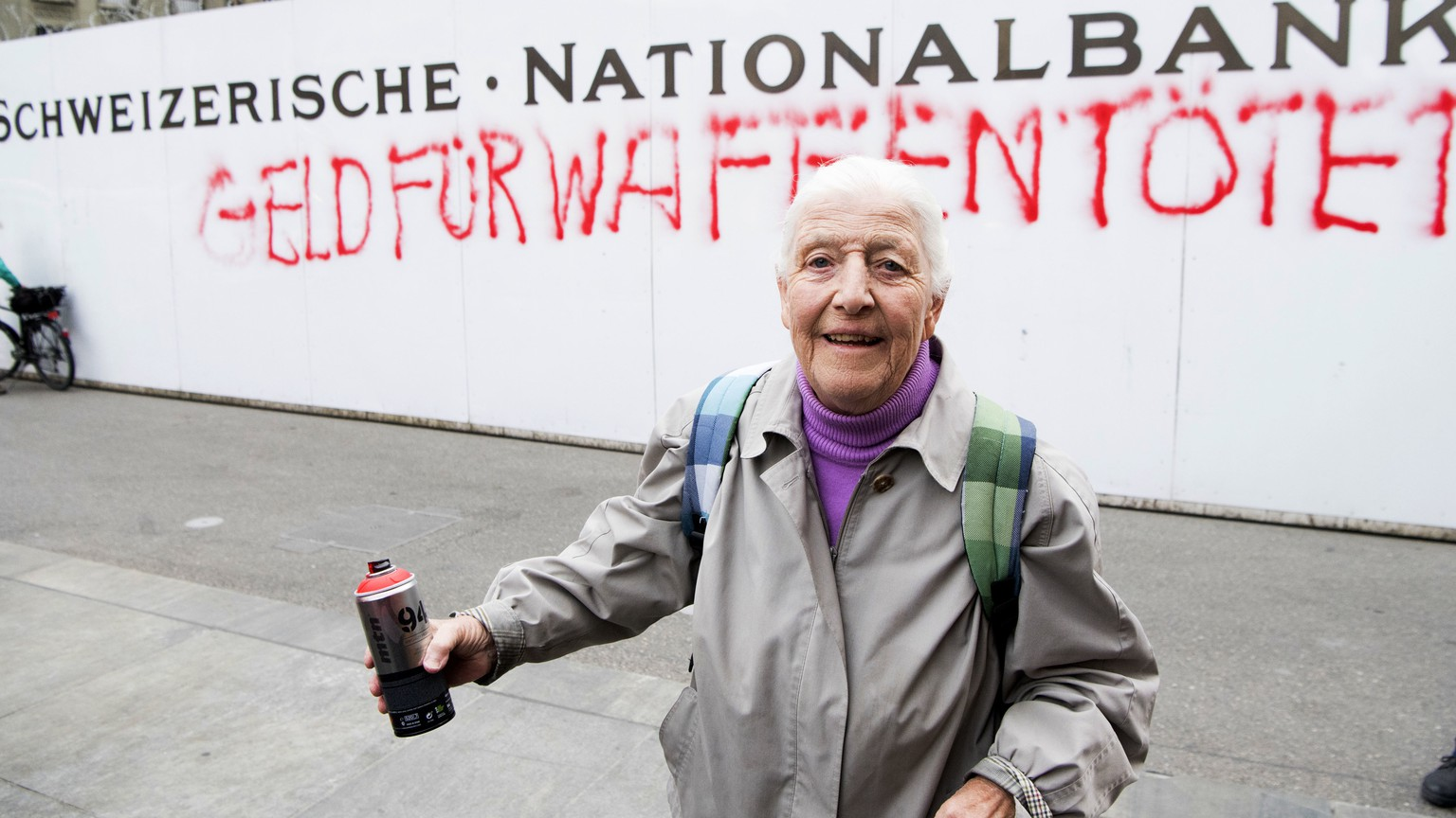 86-year-old activist Louise Schneider poses for media after spraying the words
