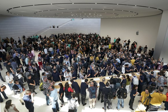 Event attendees get a look at the new products at the Steve Jobs Theater during an event to announcement Tuesday, Sept. 10, 2019, in Cupertino, Calif. (AP Photo/Tony Avelar)