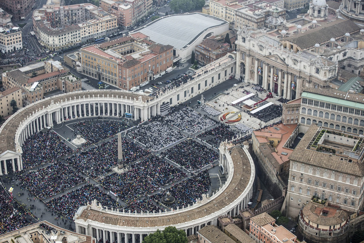 In this photo taken from an helicopter and released by the Italian Police, a view of  St. Peter's Square at the Vatican, packed with faithful Sunday, April 27, 2014. Tens of thousands of people have filled St. Peter's Square for a historic day of four popes, with Popes Francis and Benedict XVI honoring John XXIII and John Paul II by declaring them saints in the first ever canonization of two pontiffs. (AP Photo/Massimo Sestini, Italian Police, ho)