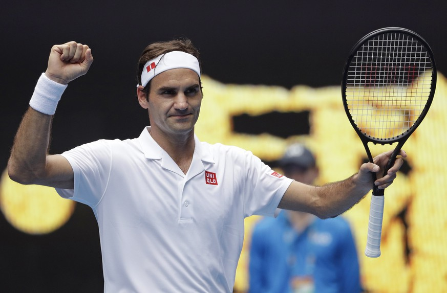 Switzerland's Roger Federer celebrates after defeating Britain's Daniel Evans in their second round match at the Australian Open tennis championships in Melbourne, Australia, Wednesday, Jan. 16, 2019. (AP Photo/Mark Schiefelbein)