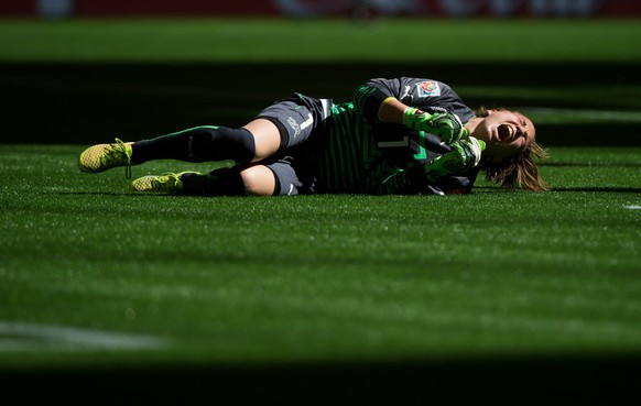 Switzerland goalkeeper Gaelle Thalmann reacts after a collision with Canada's Melissa Tancredi during the first half of the FIFA Women's World Cup round of 16 soccer action in Vancouver, British Columbia, Canada, Sunday, June 21, 2015. (Darryl Dyck/The Canadian Press via AP) MANDATORY CREDIT