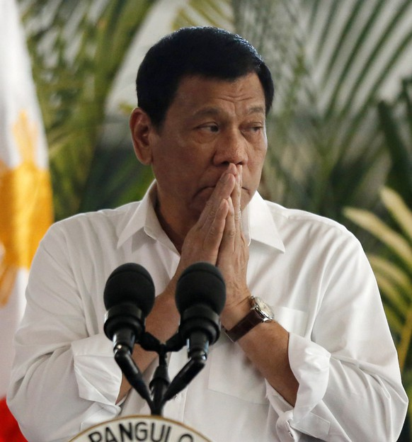 epa05623482 Filipino president Rodrigo Duterte gestures during a departure ceremony at the international airport in Manila, Philippines, 09 November 2016. Duterte left for Thailand and Malaysia to expand bilateral ties in areas of maritime security and defense cooperation, according to news reports.  EPA/EUGENIO LORETO